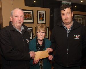 Mary Service receives a cheque for the Carrick Day Centre receives a cheque for E360 from Brendan Byrne and Daniel Moy on the Midwest Donegal Vintage Club, part proceeds of their Kilcar Tractor run. (John/jmac.ie)