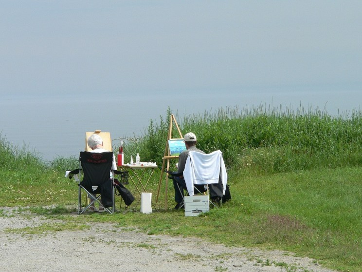 Two artists creating in plein air.