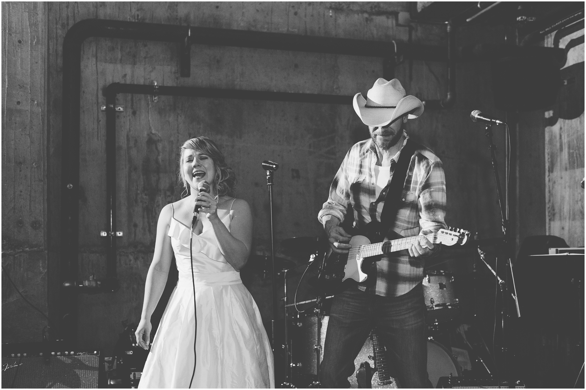 Bride singing at her own wedding at the Fremont Foundry in Seattle. Image captured by Ardita Kola Photography.
