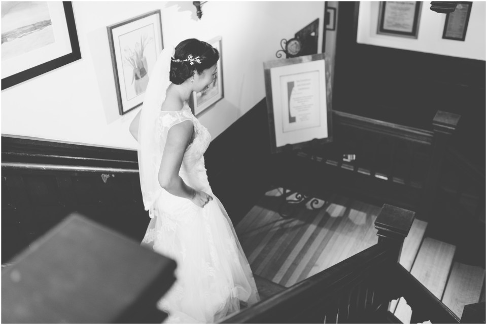 Bride coming down the stairs for first look