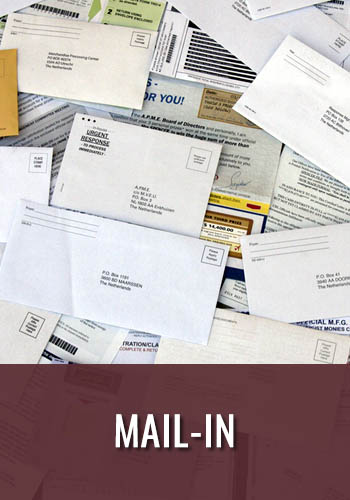 scattered mail envelopes for mail in ballots