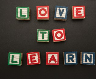 Love to learn message in wooden blocks on blackboard