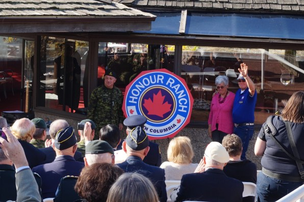 Donna and Rick Wanless joined Honour House Society president Allan De Genova for unveiling of Honour Ranch sign.
