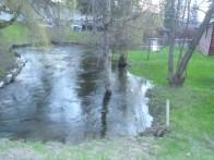 Rising creek at Pinantan Lake made it necessary to sandbag house at right.