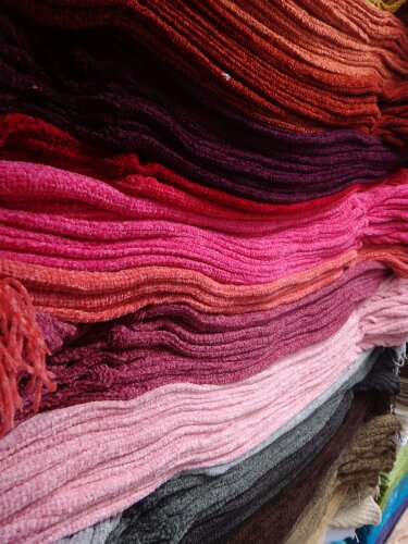 Otavalo is know for it indigenous textile handiwork. The colors in these scarves were so vibrant.