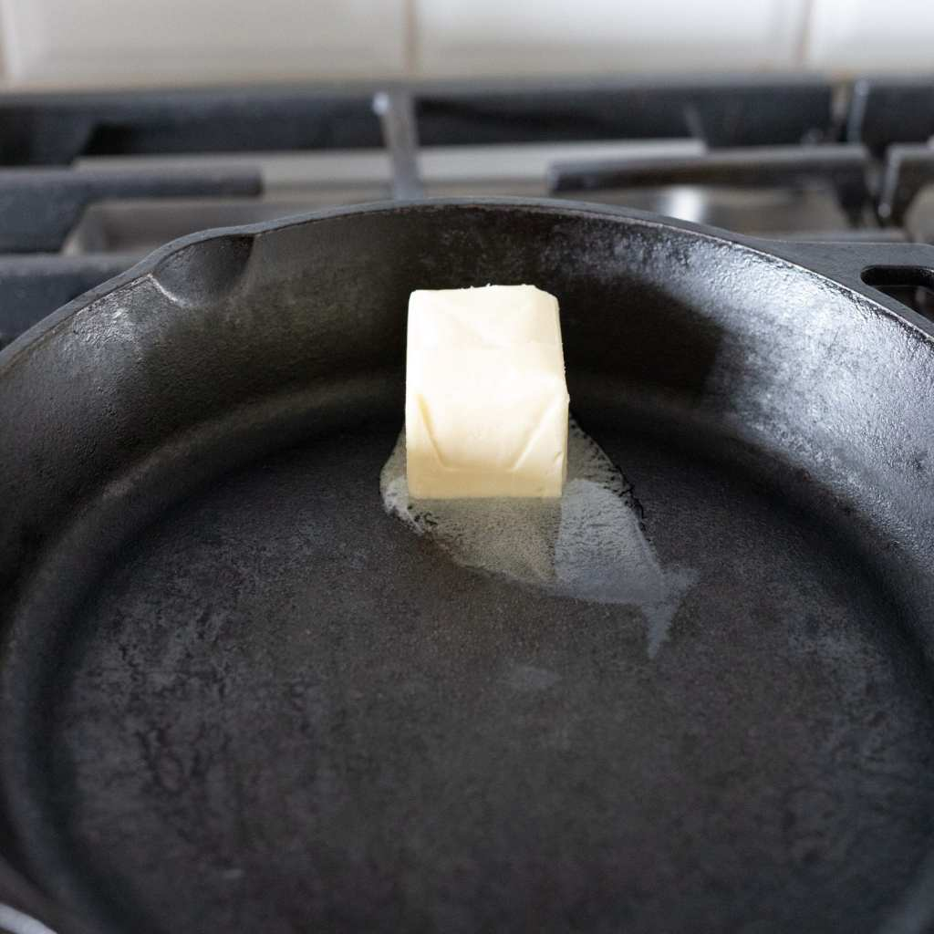 butter melting in cast iron skillet