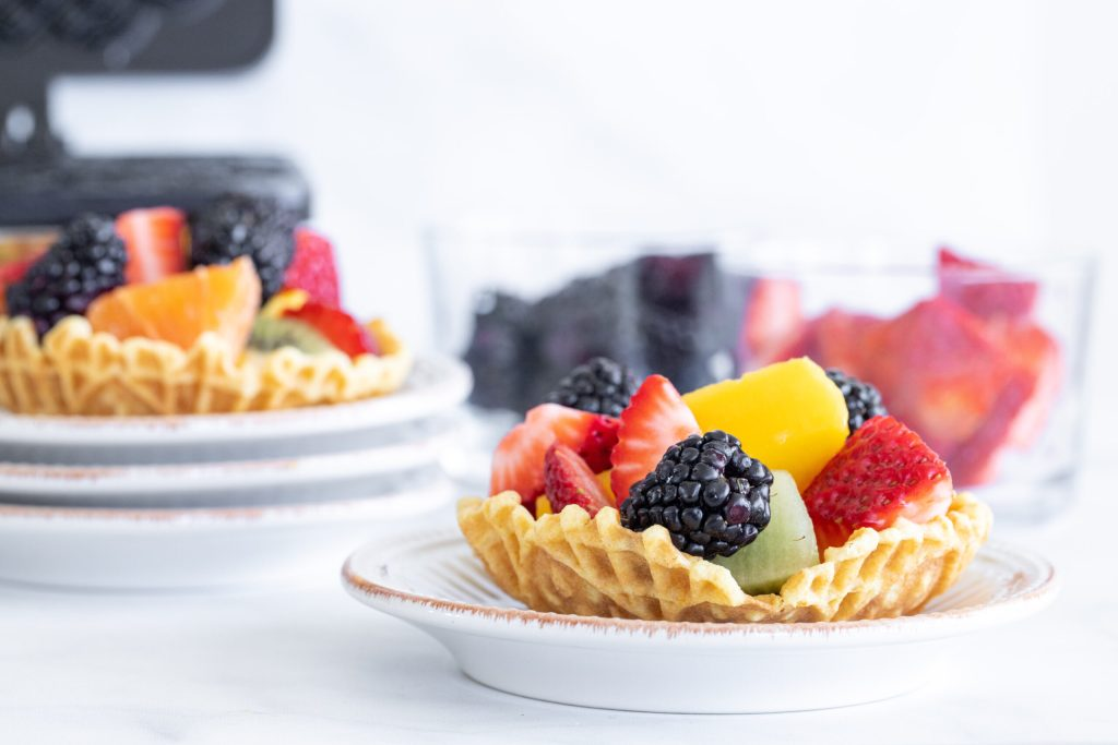 pizzelle cookie cups filled with assorted fruits