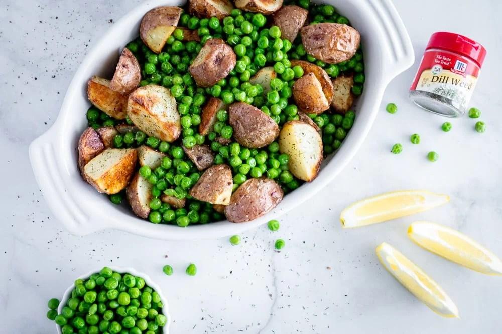 Simple potato and green pea side dish in white ceramic dish