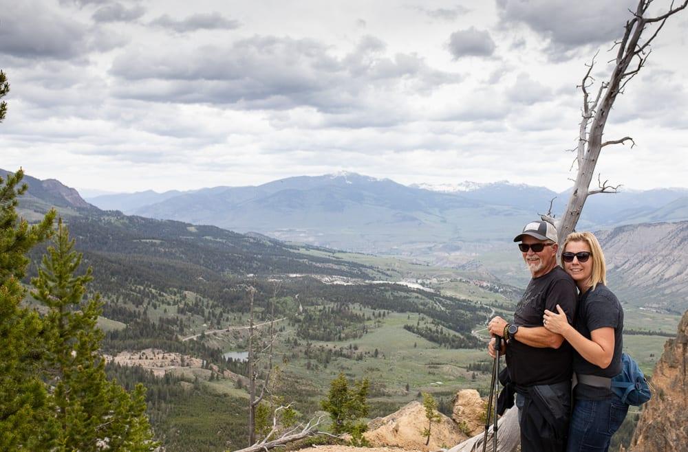 husband and wife embracing on hiking trail