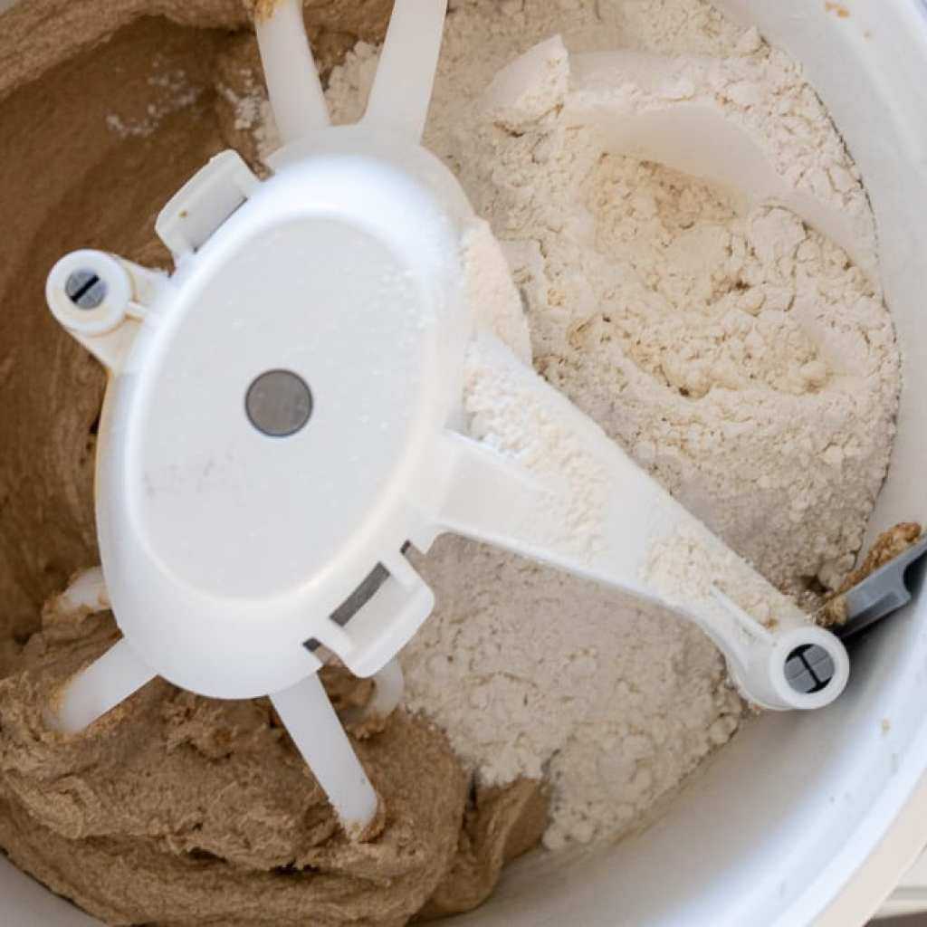 mixing chocolate chip cookie dough in a bosch mixer