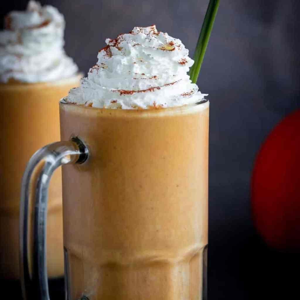 Simple pumpkin milkshakes in glass steins