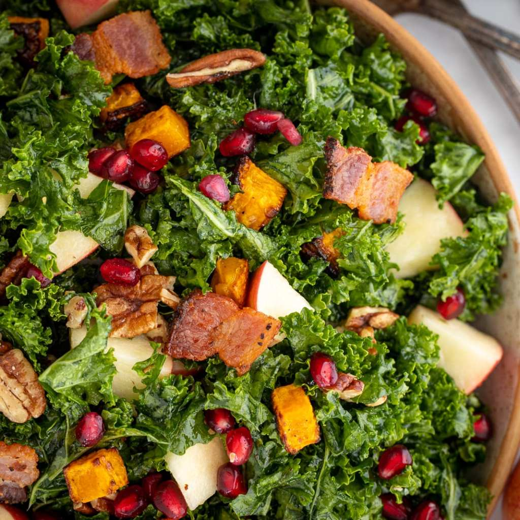 Autumn Kale Salad with Butternut Squash in a ceramic bowl