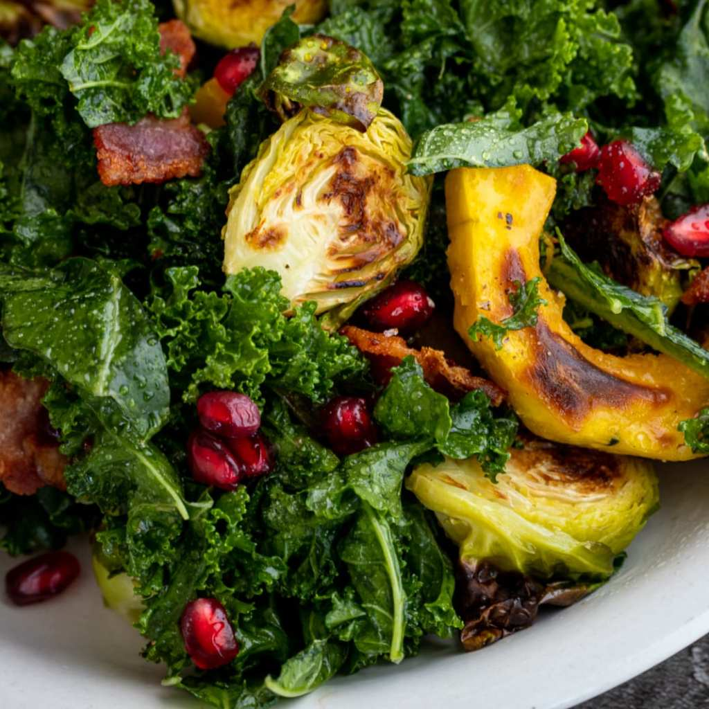 Kale Salad With Roasted Delicata brussell sprouts and pomegranates