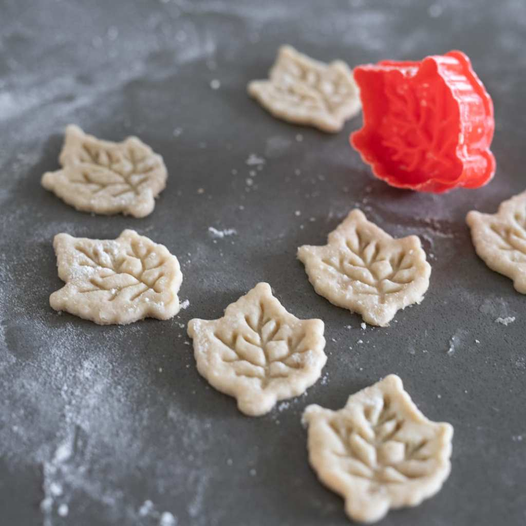 leaves cut from pie dough for decoration
