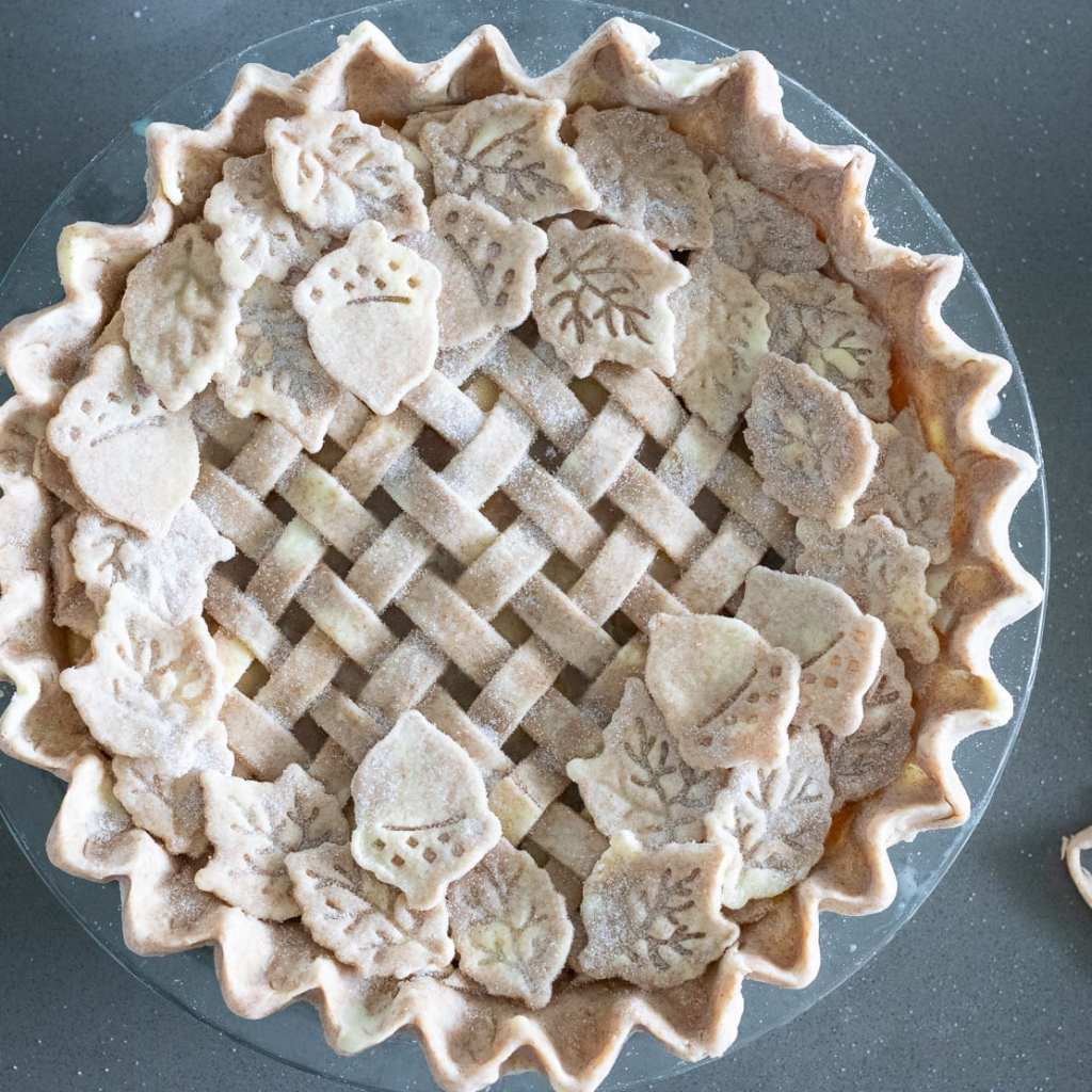 sprinkle pie dough with granulated sugar on pie topping