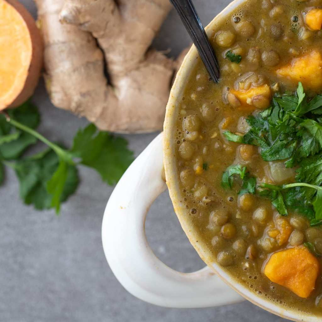 Simple Lentil and Sweet Potato Soup in small white crock with cilantro on top