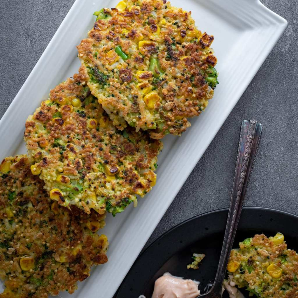 Broccoli and Corn Millet Fritters on a platter for serving