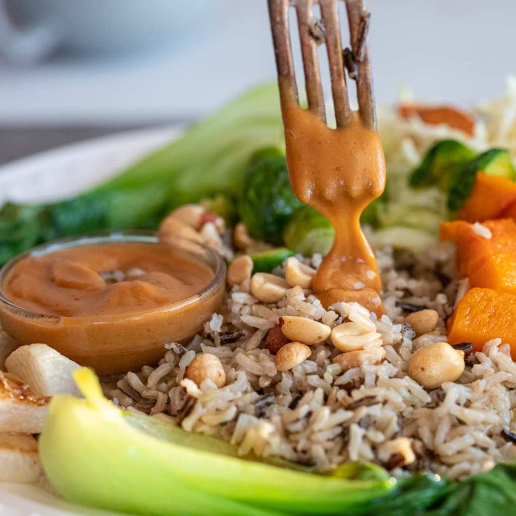 Simple and Healthy Vegetarian Rice Bowl in a ceramic bowl with peanut dressing