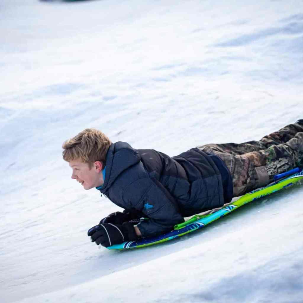boy sledding steamboat gulch idaho