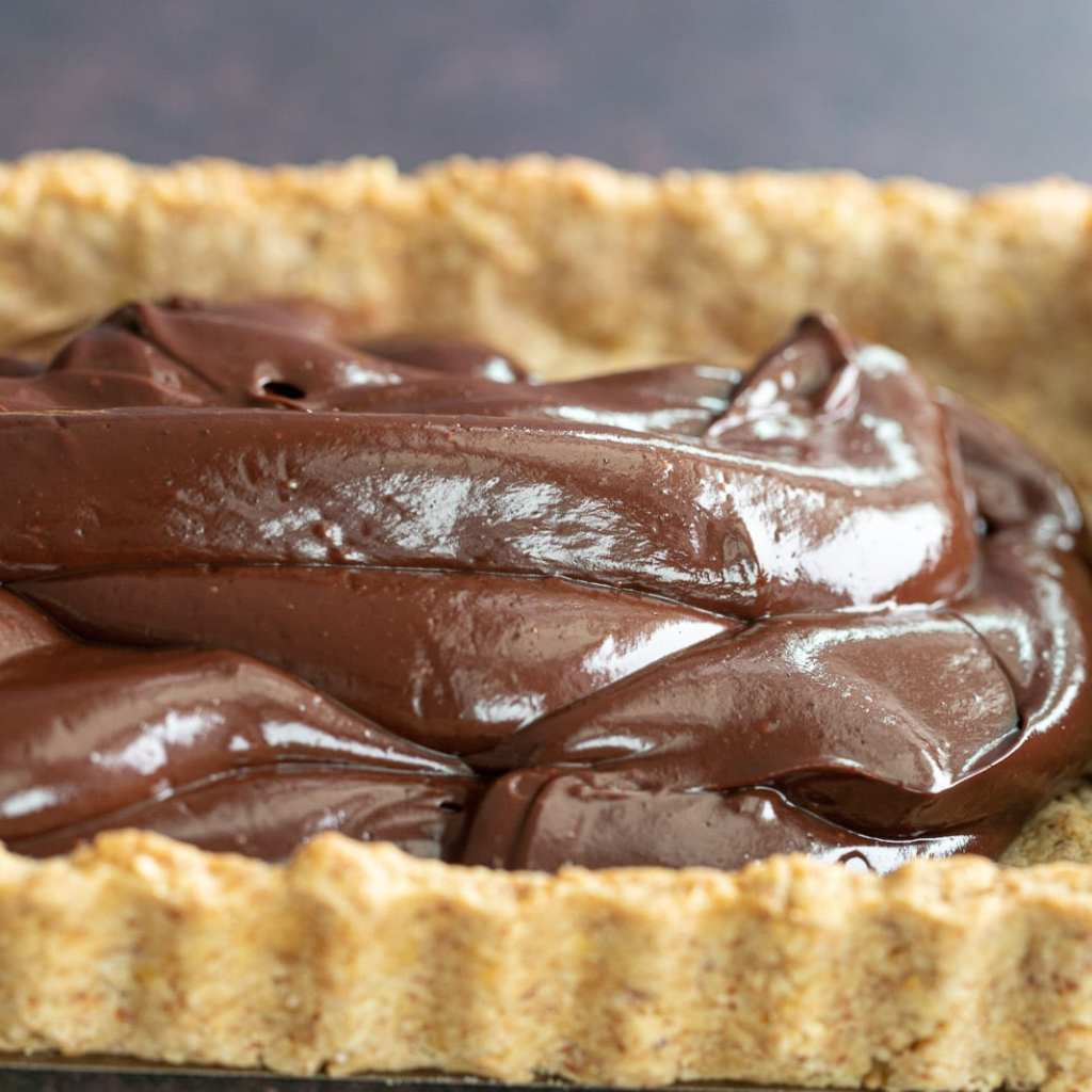 dark chocolate ganache in a almond tart shell