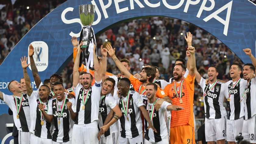 Juventus' Italian defender Giorgio Chiellini lifts the Supercoppa Italiana after winning the final between Juventus and AC Milan at the King Abdullah Sports City Stadium in Jeddah on January 16, 2019.