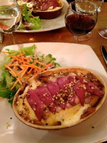 Potato and cheese gratin with smoked duck
