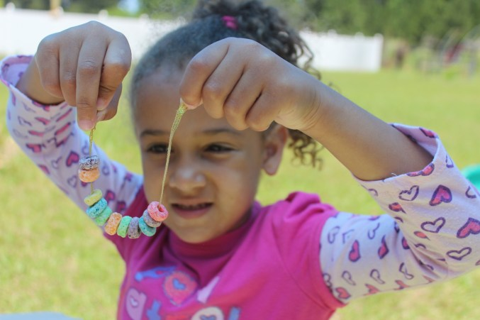 Making a fruit loops bracelet can help your special needs child or toddler strengthen common developmental issues like hand-eye coordination and focus.