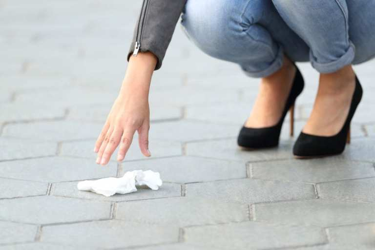woman picking up litter