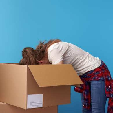 woman looking in box