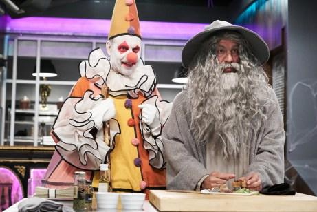 Host Alton Brown with Judge Simon Majumdar during Round 1 judging, as seen on Food Network's Cutthroat Kitchen, Season 14.