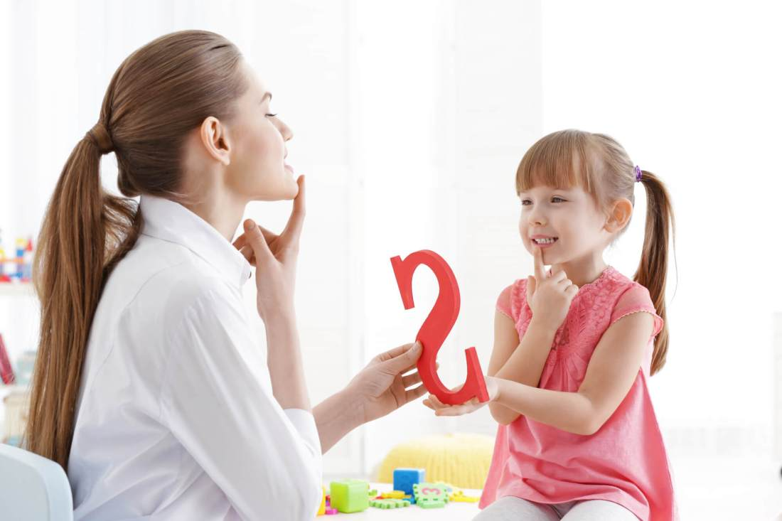 Cute child receiving speech therapy