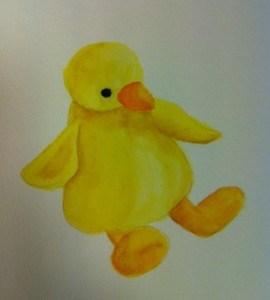 Akvarellmålning föreställande en gul kyckling. Påskpynt.
