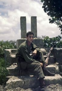 Jerry Smith on Okinawa with his M1 Carbine and other assorted equipment near an Okinawan tomb.