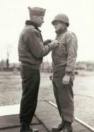 Brig.Gen. Charles D. Palmer receiving the Legion of Merit from Lt.Gen. Alexander M. Patch.