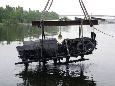 The Spitfire is removed from the River Caen, France. It was re-immersed in the river to prevent deterioration while transportation plans were made. (Credits: Australian Embassy in France)