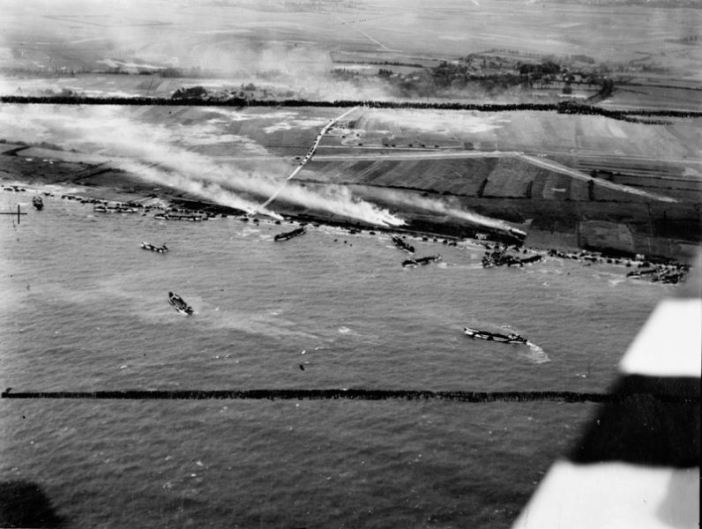 Aerial photo of the junction of King Red and King Green, Gold Beach assault area, during the landing of 50th Infantry Division, 6 June 1944. The Mont Fleury battery are visible in front of the village of Ver-sur-Mer.