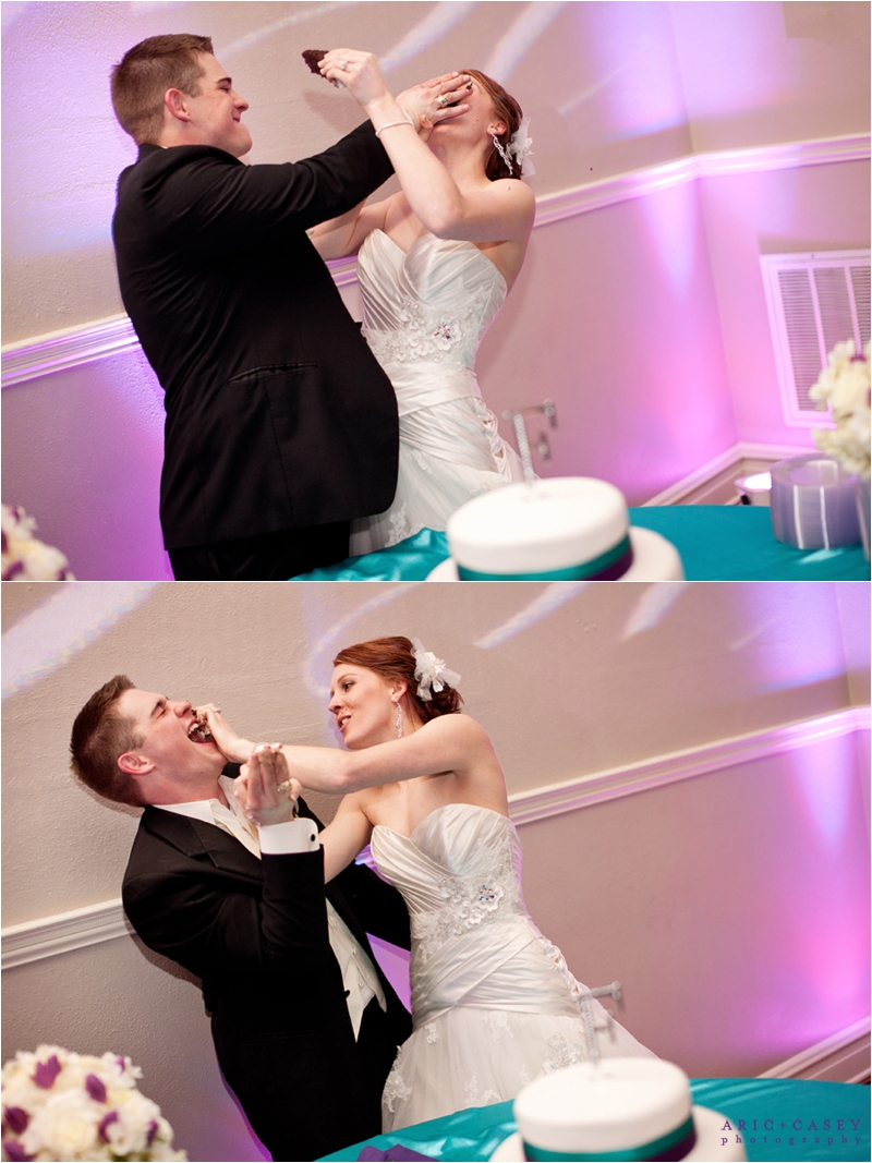 Smashing cake in each others' faces wedding day