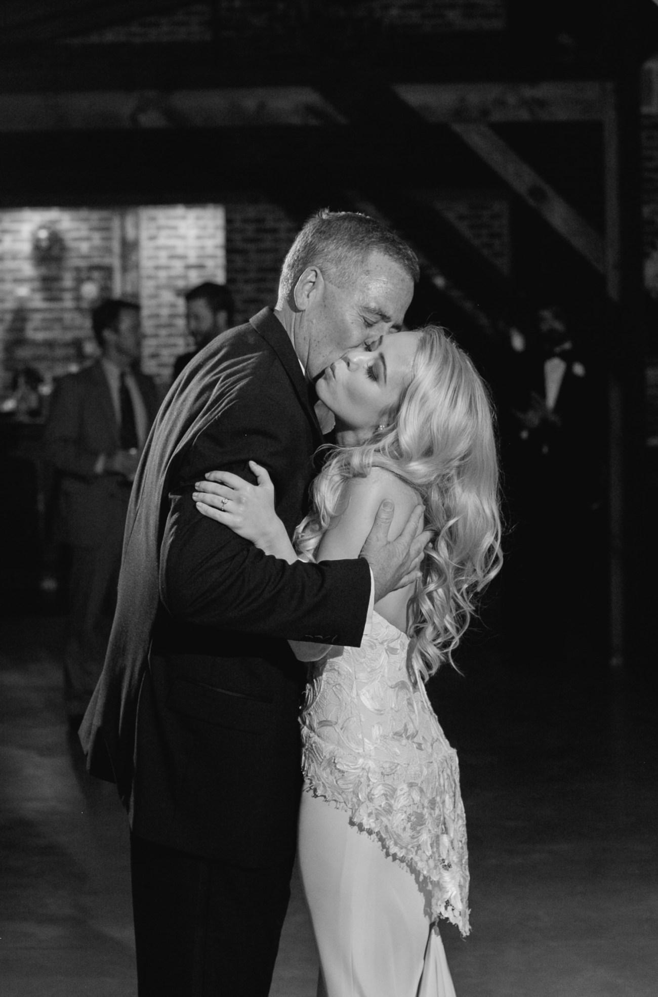 dad kisses bride