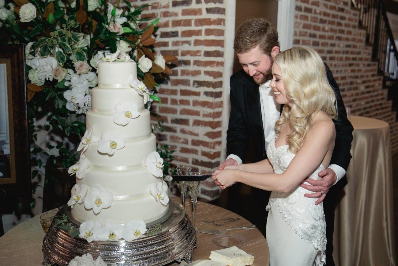 bride and groom cutting lubbock wedding cake