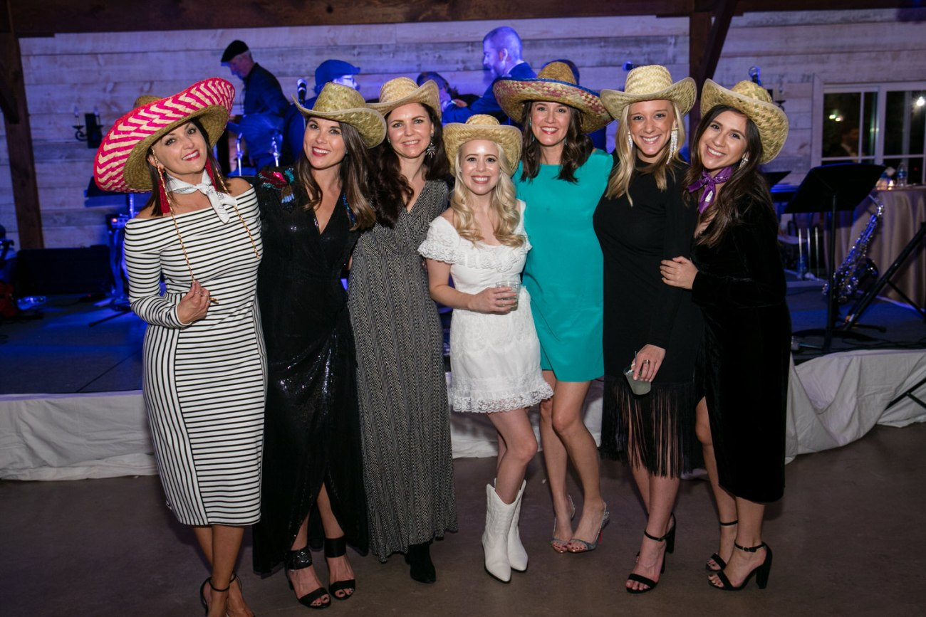 bride and friends in cowboy hats