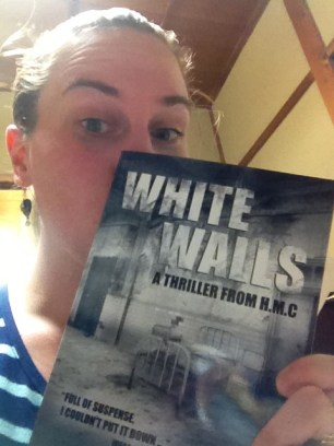 "In 2013, I started reading books by people I actually KNOW. This was pretty cool for me! Here I am holding a signed copy of ""White Walls"", by H.M.C."