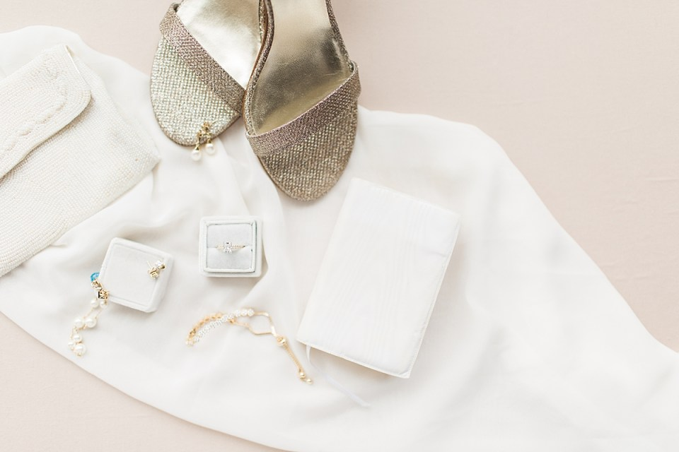 Arielle Peters Photography | Bride's shoes and jewelry on wedding day inside the Basilica of the Sacred Heart in Notre Dame, Indiana.