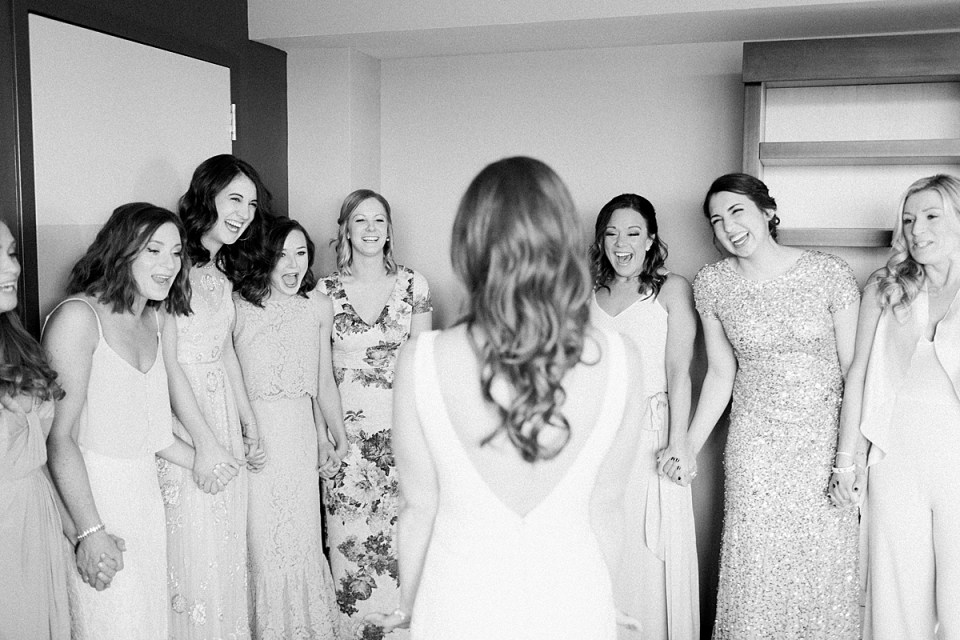 Arielle Peters Photography | Bride and bridesmaids having first reveal on wedding day inside the Basilica of the Sacred Heart in Notre Dame, Indiana.