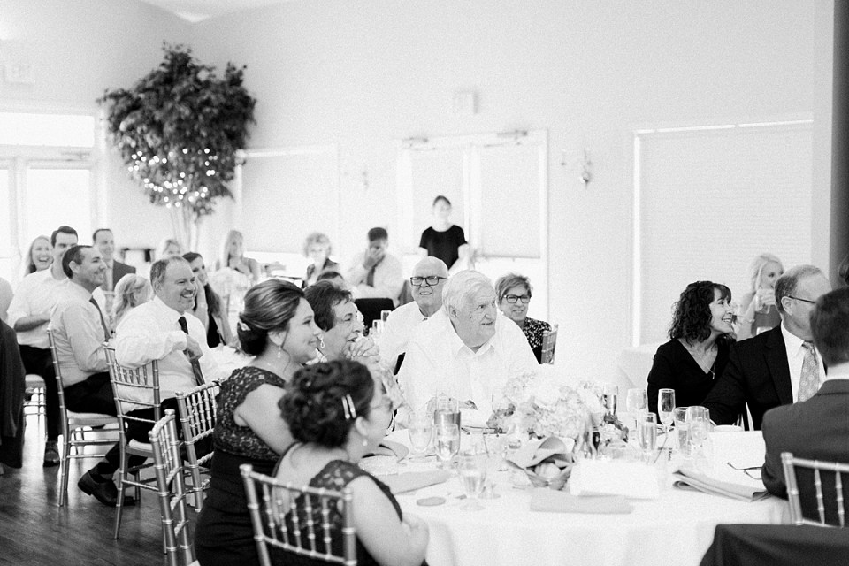 Arielle Peters Photography | Wedding guests laughing at the wedding reception at The Blue Heron at Blackthorn in South Bend, Indiana on wedding day.
