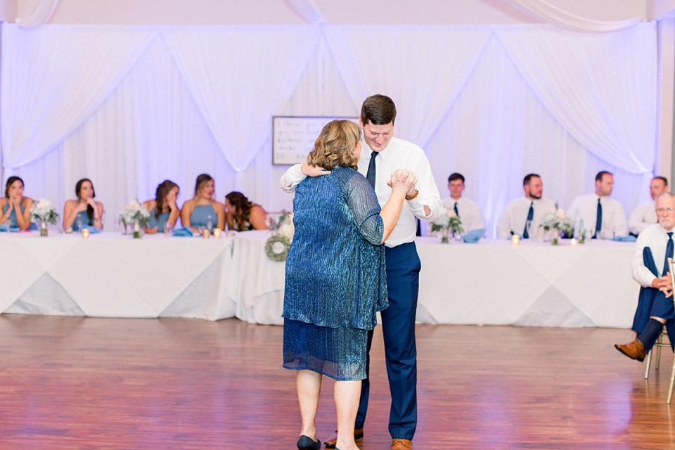 Arielle Peters Photography | Mother of the groom and groom dancing at the wedding reception at The Blue Heron at Blackthorn in South Bend, Indiana on wedding day.