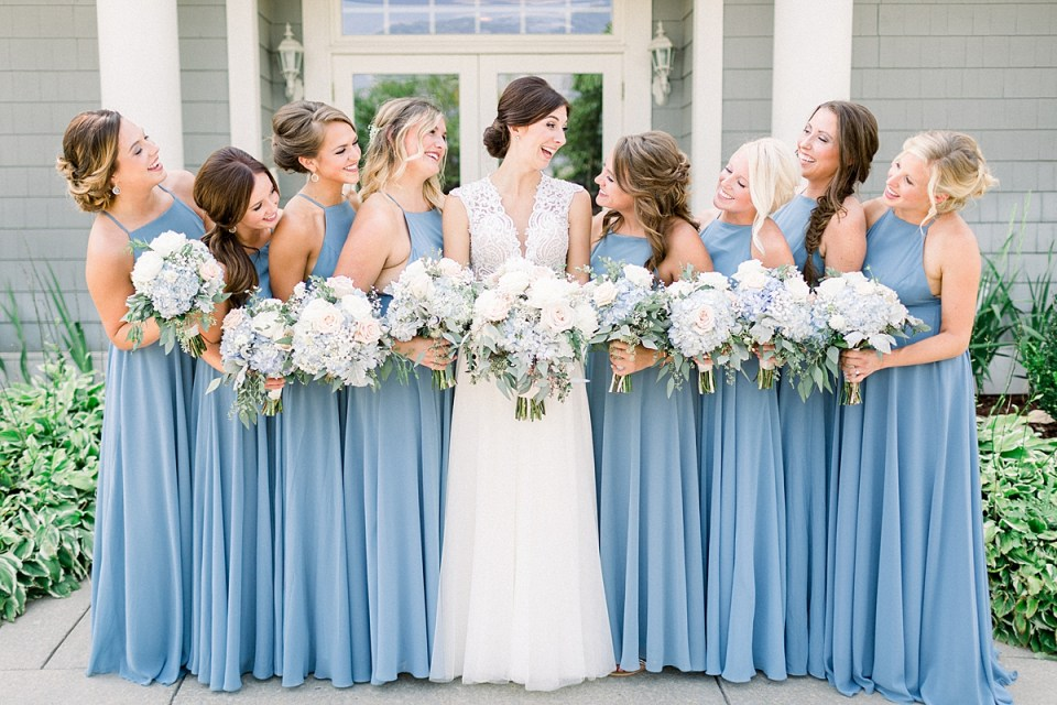 Arielle Peters Photography   Bride and bridesmaids laughing outside at The Blue Heron at Blackthorn in South Bend, Indiana on wedding day.