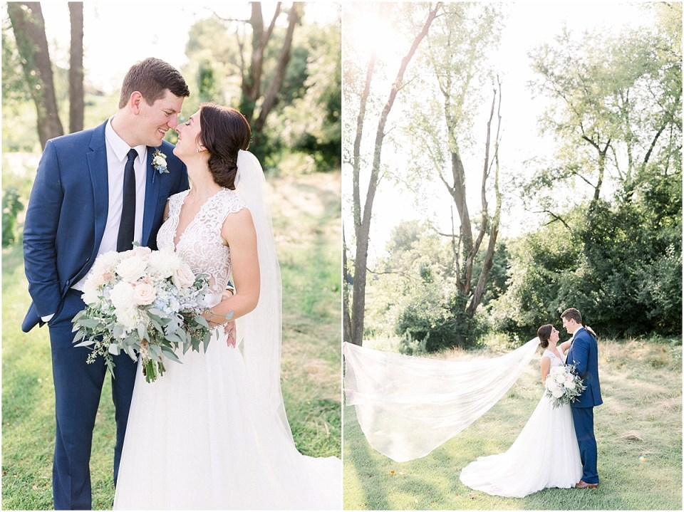Arielle Peters Photography | Bride and groom kissing with veil flowing outside at The Blue Heron at Blackthorn in South Bend, Indiana on wedding day.