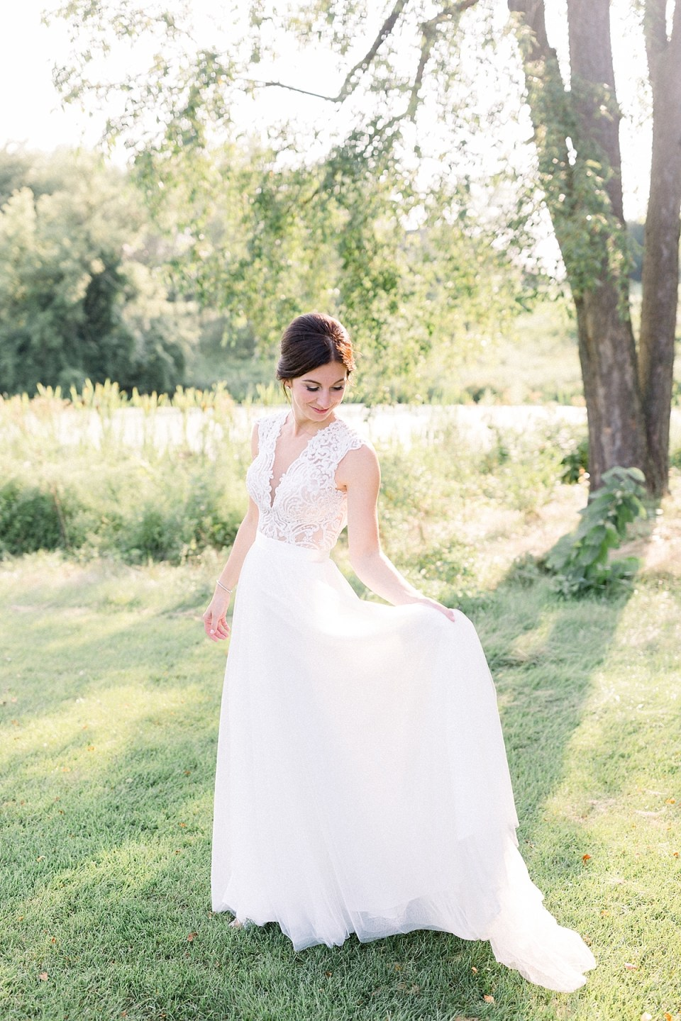 Arielle Peters Photography | Bride dancing in her gown outside at The Blue Heron at Blackthorn in South Bend, Indiana on wedding day.