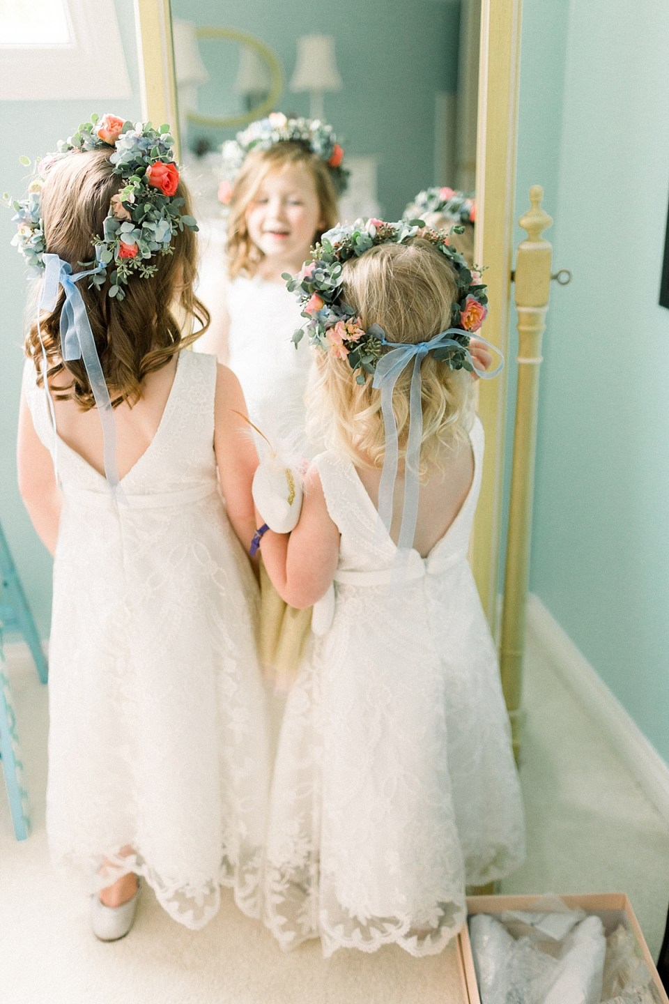 Arielle Peters Photography | Flower girls in flower crowns and dresses at Sycamore Hills Golf Club in Fort Wayne, Indiana on wedding day.