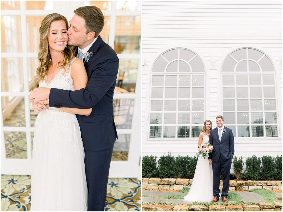 Arielle Peters Photography | Bride and groom kissing by big windows at Sycamore Hills Golf Club in Fort Wayne, Indiana on wedding day.